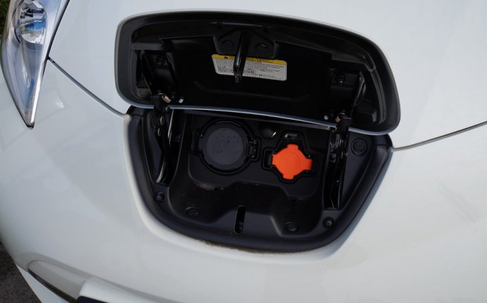 Free photo Nissan Leaf Recharging Electric Car Charging Socket