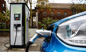 An electric car is charged on a London street.