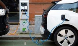 Two electric cars charging on a city street, UK